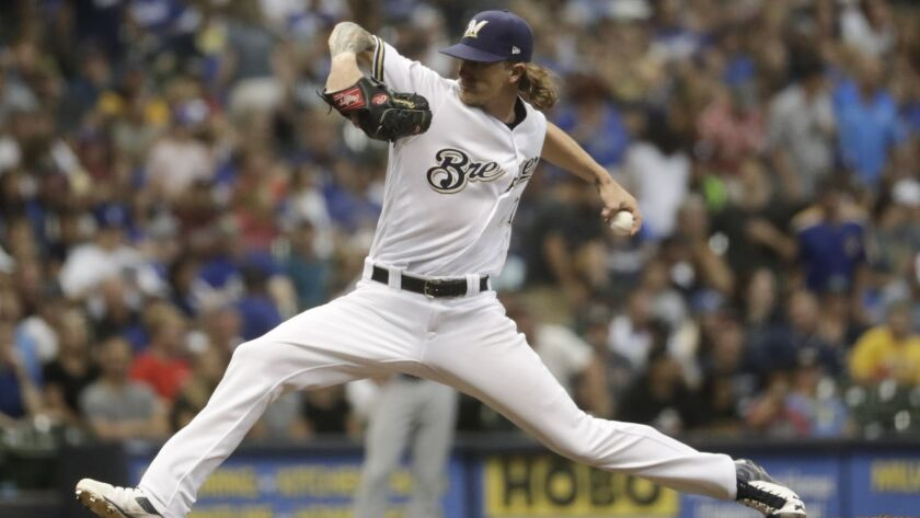 Milwaukee Brewers relief pitcher Josh Hader throws during the seventh inning of a baseball game agai