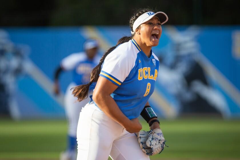UCLA pitcher Megan Fariamo celebrates during an NCAA super regional game against James Madison University  on May 25 at Easton Stadium.