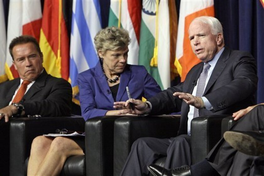 Former California Gov. Arnold Schwarzenegger, left, and moderator Cokie Roberts listen as Sen. John McCain, R-Ariz., speaks at the inaugural symposium sponsored by the Schwarzenegger Institute for State and Global Policy, at the University of Southern California in Los Angeles Monday, Sept. 24, 201