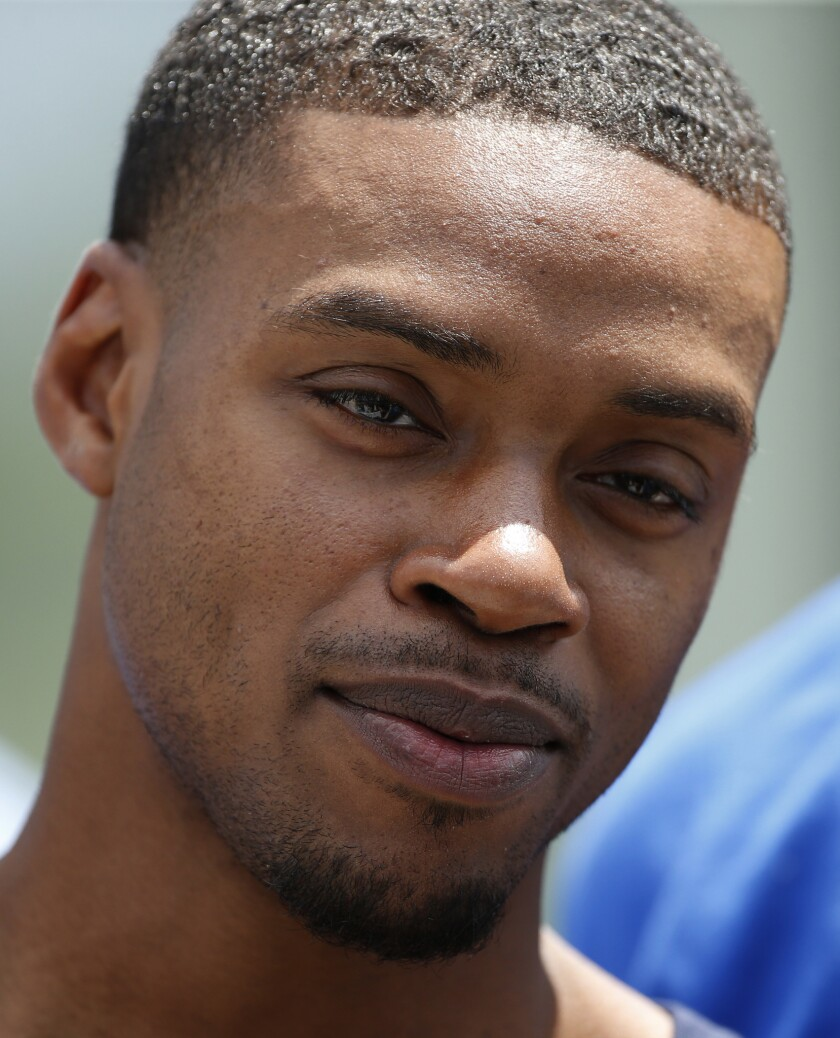 Boxer Errol Spence speaks with media members during an organized team activity at its NFL football t
