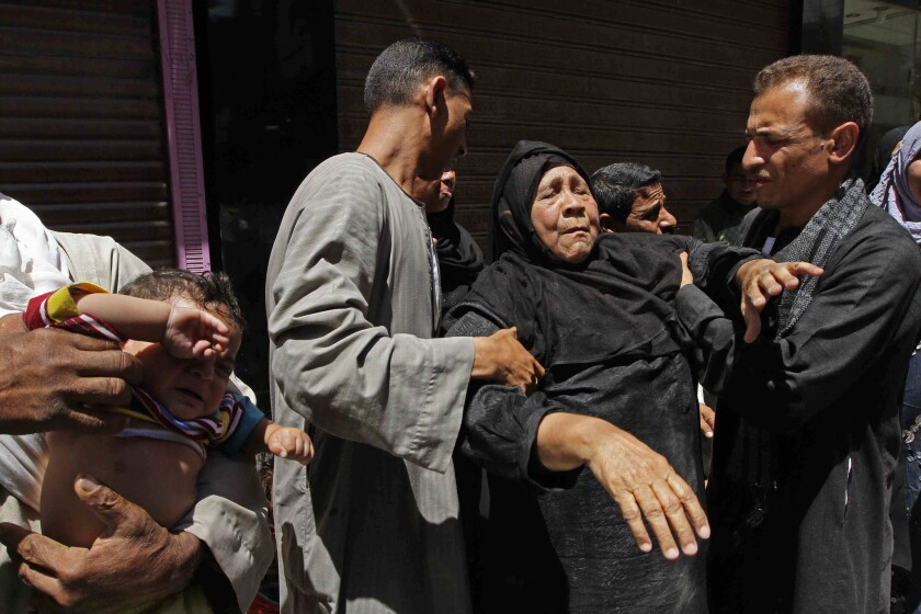 A relative of a Muslim Brotherhood member who was sentenced to death reacts outside a courtroom in Minya, Egypt, on Saturday.