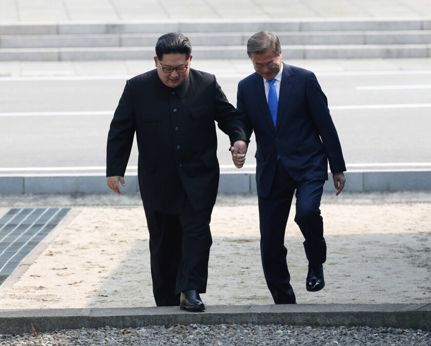 North Korean leader Kim Jong Un, left, and South Korean President Moon Jae-in meet before the rival nations' historic summit in April 2018.