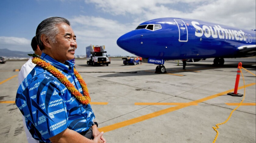 Hawaii Gov. David Ige greets Southwest Airlines' inaugural flight to Hawaii touches down in Daniel K