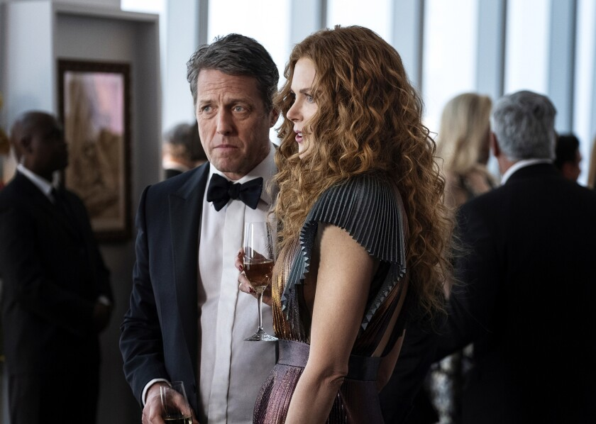 "This image released by HBO shows Hugh Grant, left, and Nicole Kidman in a scene from ""The Undoing."" The Nielsen company said some three million people watched on Sunday to learn the mystery's resolution in the limited series. (HBO via AP)"