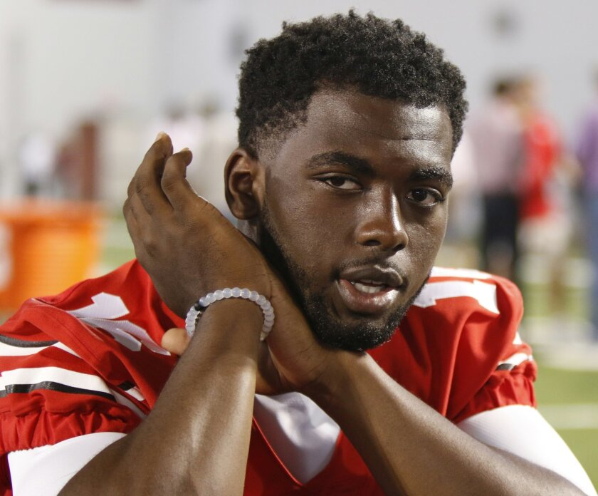 IFLE - In this Aug. 16, 2015, file photo, Ohio State quarterback J.T. Barrett speaks to reporters during the university's NCAA college football media day in Columbus, Ohio. Ohio State quarterback J.T. Barrett has been suspended for one game after being cited with a misdemeanor offense of operating