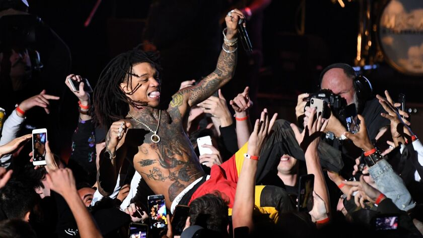 LOS ANGELES, CALIFORNIA , OCTOBER 31, 2018-Rae Sremmurd surfs the crowd during a memorial concert fo