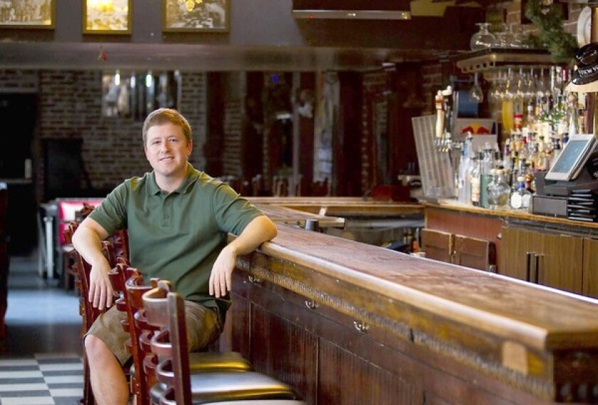 Scott Lewis is the general manager of The Blue Beet in Newport Beach. The site once served as a Prohibition-era speakeasy — possibly even housing a brothel around the same time — before undergoing several transformations into more legal enterprises, including a general market and cigar shop.