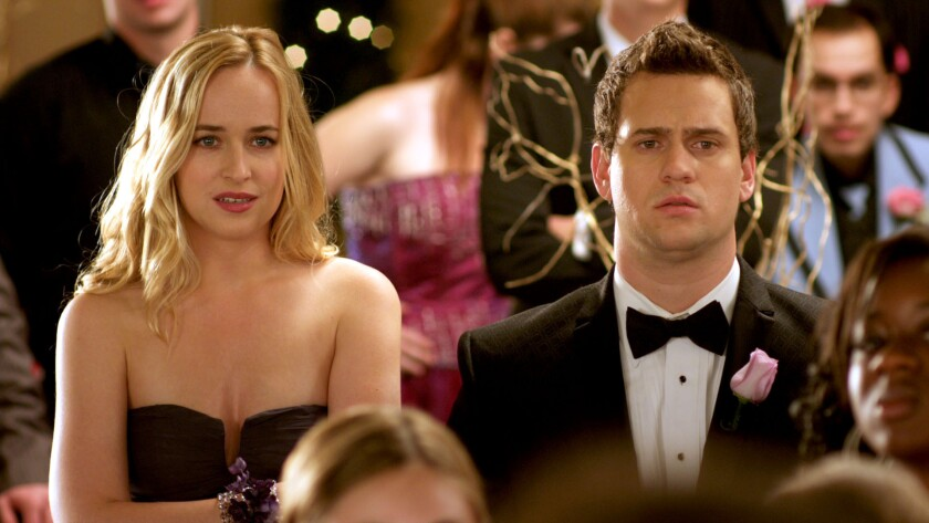 "Em (Dakota Johnson) and Matty (Hunter Cope) in ""Date and Switch."""