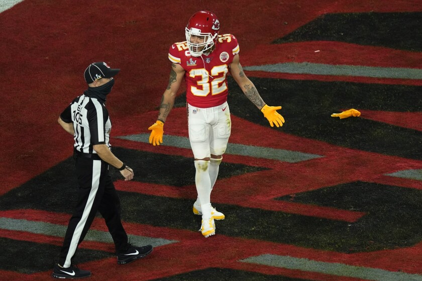 Kansas City Chiefs' Tyrann Mathieu (32) talks with back judge Dino Paganelli (105) during the first half of the NFL Super Bowl 55 football game against the Tampa Bay Buccaneers Sunday, Feb. 7, 2021, in Tampa, Fla. (AP Photo/Charlie Riedel)