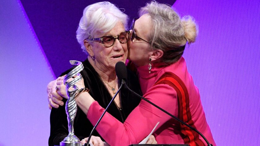 Designer Ann Roth, left, gets a kiss from Meryl Streep after giving Streep the Distinguished Collaborator Award during the 19th Costume Designers Guild Awards.