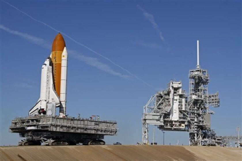 Space shuttle Discovery atop the crawler transporter nears the end of it's 3.4 mile journey to pad 39A to prepare for the next launch at Kennedy Space Center in Cape Canaveral, Fla., Wednesday, Jan. 14, 2009. Discovery is scheduled to launch on Feb. 12.(AP Photo/John Raoux)