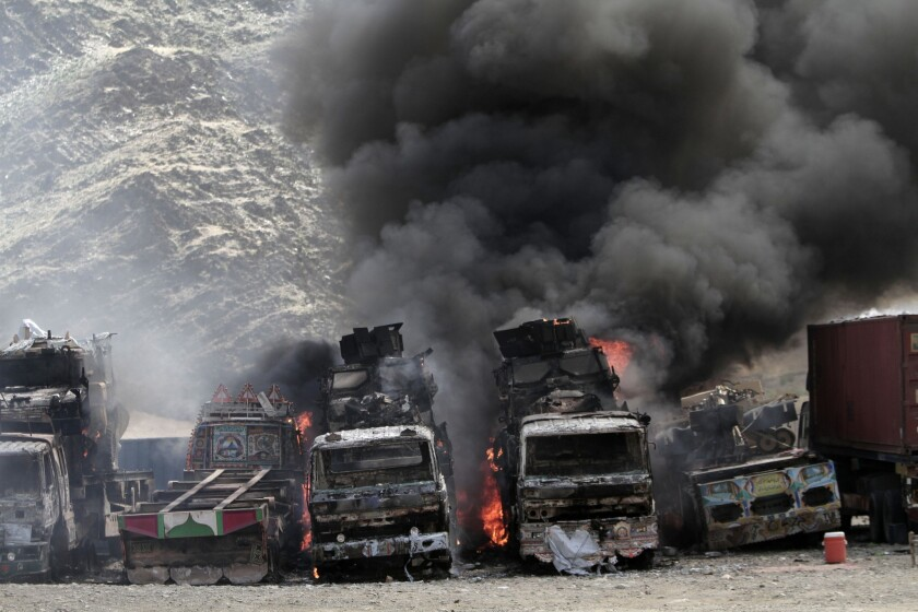 Smoke rises from NATO supply trucks following a strike by militants on a U.S. base in the Torkham area near the Pakistan-Afghanistan border. The Taliban claimed responsibility for the strike.