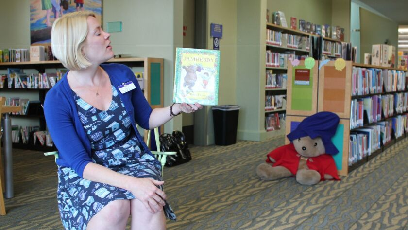 Riford Library children's librarian Angie Stava begins a storytime book.