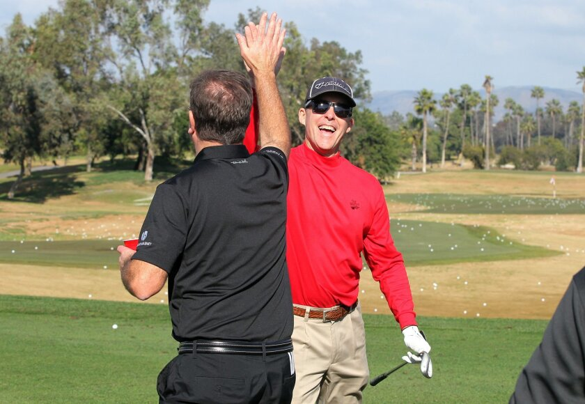 Jeff Gearhart, facing camera, high-5's friend Steve Shea after one of Jeff's two holes in one.