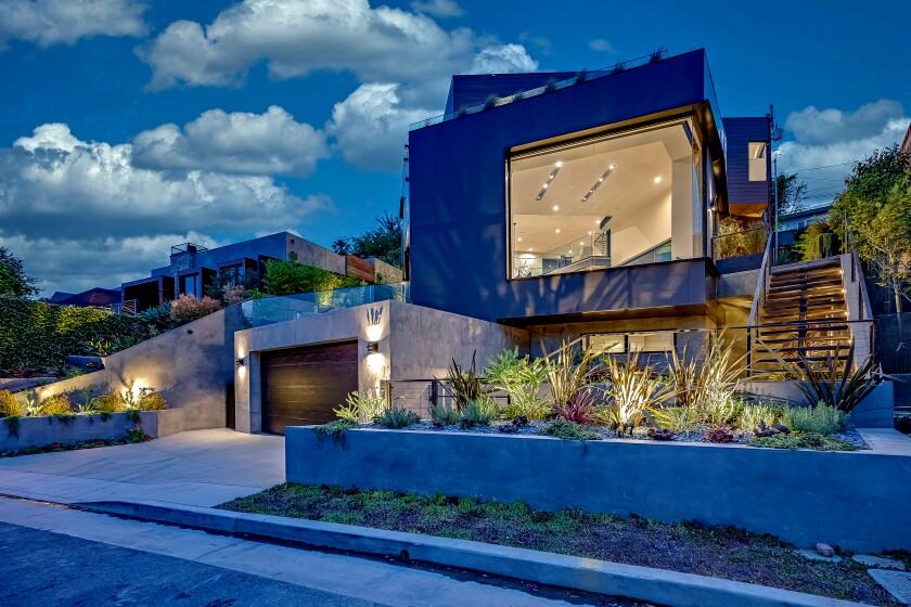 The jagged, modern home is full of custom spaces with polished concrete, heated floors, skylights and smart home amenities.
