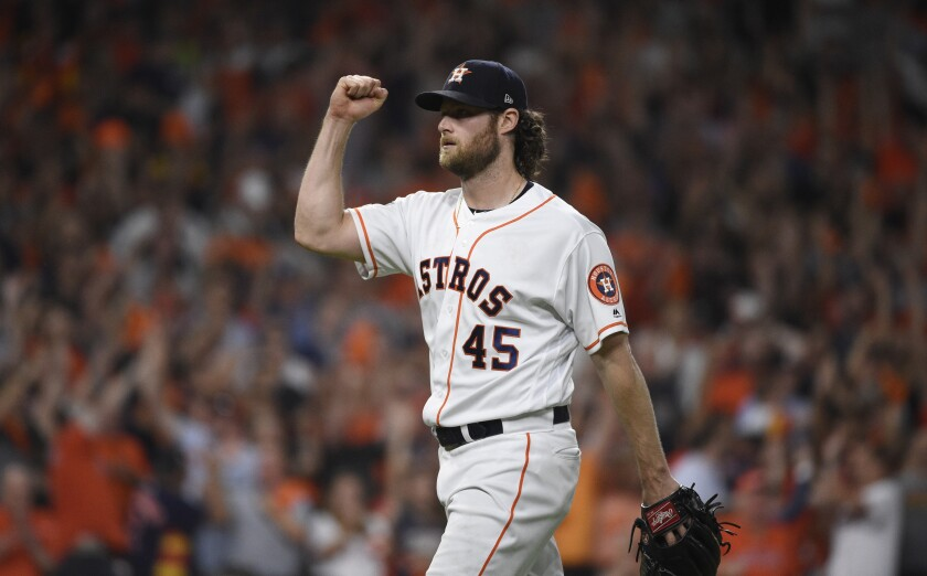 Houston Astros starting pitcher Gerrit Cole reacts to an out against the Tampa Bay Rays during the seventh inning of Game 5 of the ALDS in Houston on Thursday.