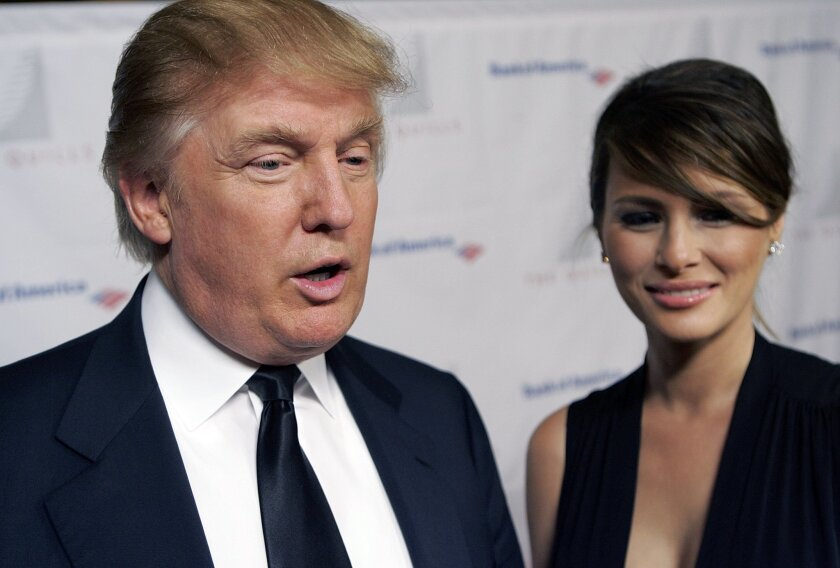 FILE - In this Oct. 10, 2006, file photo, Donald Trump and wife Melania attend the Second Annual Quill Awards at the American Museum of Natural History in New York. If the prospect of first lady Melania Trump evokes no clear image, that's no accident. Donald Trump's wife has said little in the campaign about the type of first lady she'd like to be should her husband win the Republican nomination and the presidency. (AP Photo/Stephen Chernin, File)