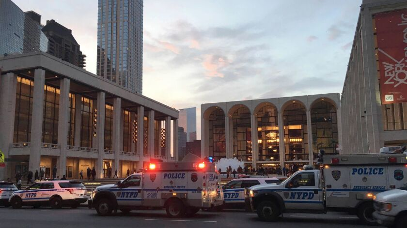 Police arrive at the Metropolitan Opera, which halted a performance after a man sprinkled a friend's ashes into the orchestra pit.