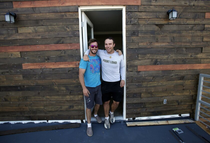 Principals Jonathan Sanders, left, and Matt Jakstis have worked to create a 3BR/2.5BA 1920 square foot home with view of Coronado and Point Loma.  The container house comes apart in six major pieces that can be transported by sea, air, truck or by rail.