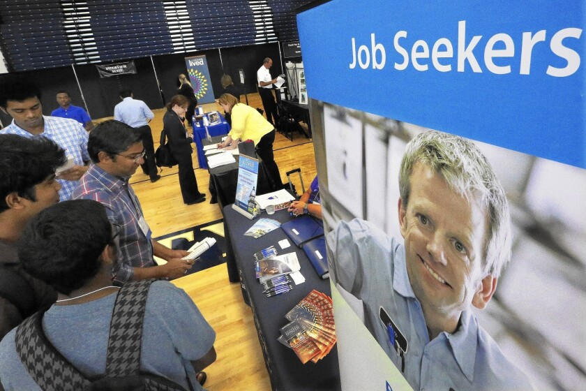 Students attend a career fair at the University of Illinois in September.