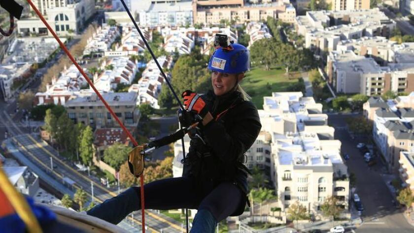 November 1st, 2014 San Diego, CA- Crista McFadden is prepped and briefed by the crew before repelling from the 39th floor of the Manchester Grand Hyatt Bay tower. Photo by David Brooks/ U-T San Diego MANDATORY PHOTO CREDIT DAVID BROOKS / U-T SAN DIEGO; ZUMA Press.