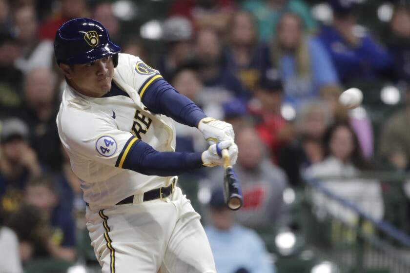 Milwaukee Brewers' Avisail Garcia hits a two-run home run during the eighth inning of the team's baseball game against the Cincinnati Reds on Thursday, July 8, 2021, in Milwaukee. (AP Photo/Aaron Gash)