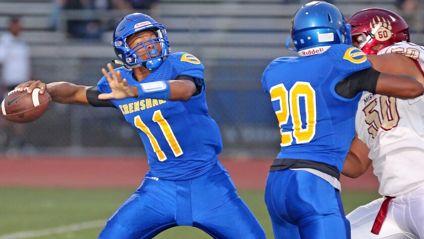 Daiyan Henley (11) was a helper to Crenshaw's football program when he was in elementary school, and now he's the Cougars quarterback.