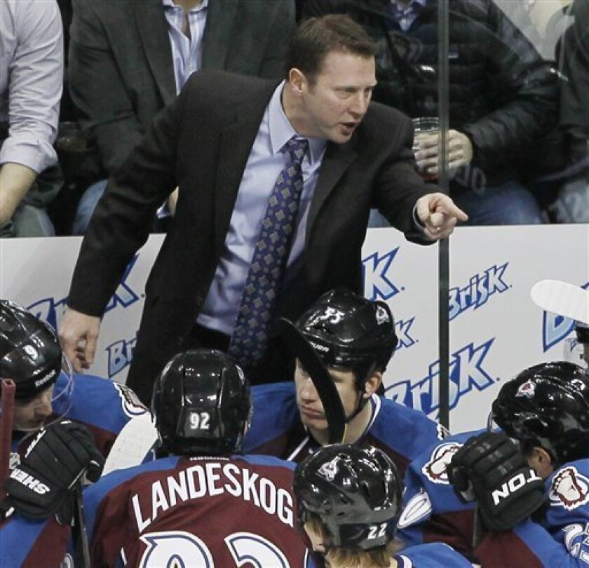 Colorado Avalanche coach Joe Sacco, back, yells at his players after the Avalanche gave up two goals to the Calgary Flames early in the first period of an NHL hockey game in Denver on Thursday, Feb. 28, 2013. (AP Photo/David Zalubowski)