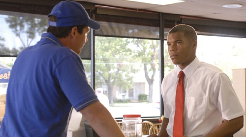 """PARTNERSHIP: Coach Eric Taylor (Kyle Chandler) meets with Brian """"Smash"""" Williams (Gaius Charles) early in the third season of """"Friday Night Lights,"""" which debuts on DirecTV before airing on NBC."""