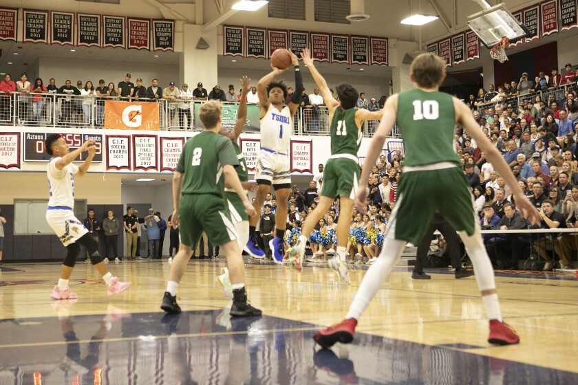 Mikey Williams, who averaged 29.9 points a game last season, shoots over Coronado in the playoffs.