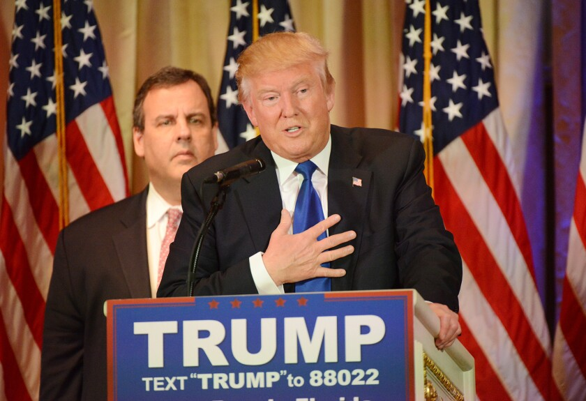 Donald Trump, with New Jersey Gov. Chris Christie, talks to reporters after his Super Tuesday victories.