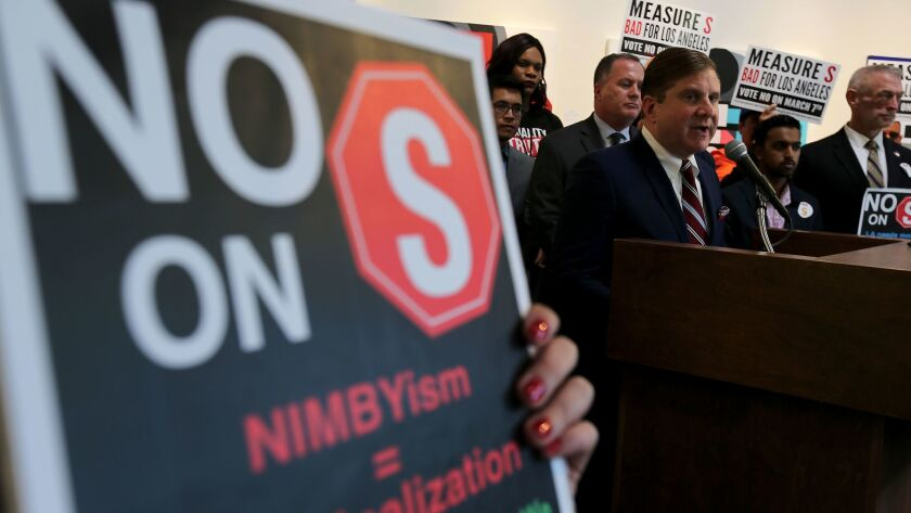Los Angeles City Controller Ron Galperin criticizes the AIDS Healthcare Foundation over its financial support for Measure S during a news conference in Hollywood on Feb. 24.