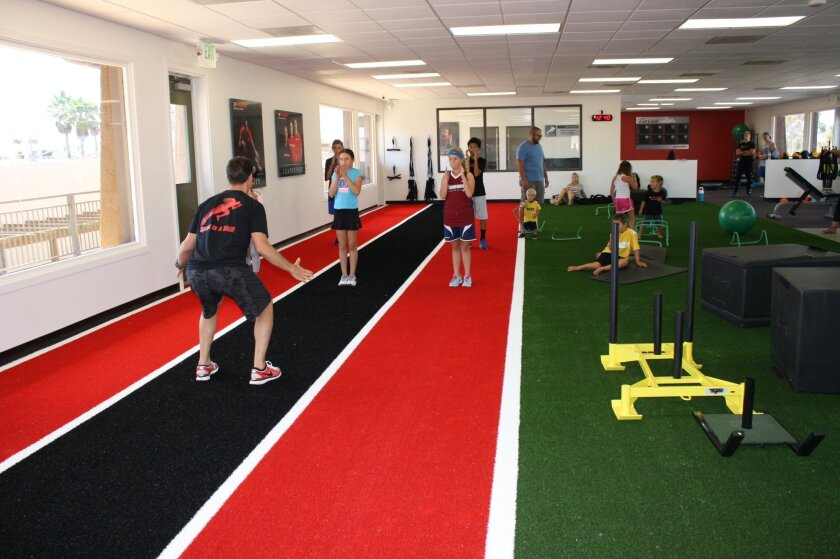 Joe Virga trains young athletes at the new Parisi Speed School in Sorrento Valley.