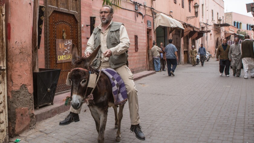"Nicolas Cage in the movie ""Army of One."""