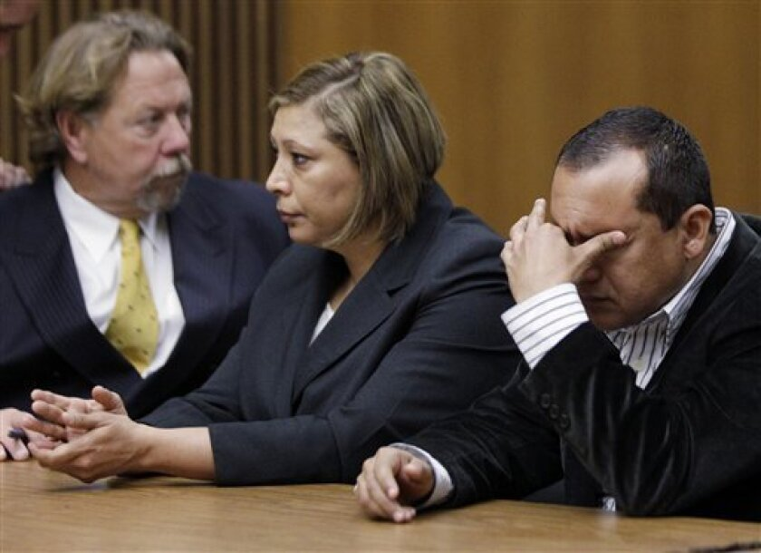 Merced Farm Labor safety coordinator Elias Armenta, right, and company owner Maria De Los Angeles Colunga, center, sit with attorney Randy Thomas during sentencing  in Stockton, Calif., Wednesday, March 9, 2011.  The two California farm supervisors charged in the 2008 heat-related death of a pregna