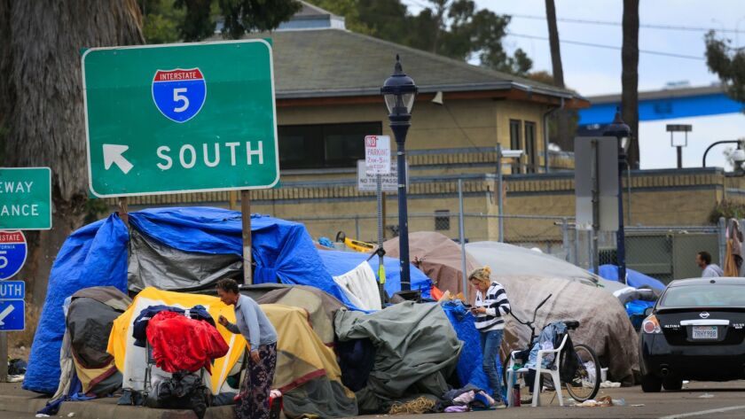Tents and other living accommodations of homeless people line 17th Street near J Street, near the southbound onramp to Interstate 5, and surrounding area, several blocks from 14th and G Streets in the East Village where a homeless woman was in labor, and