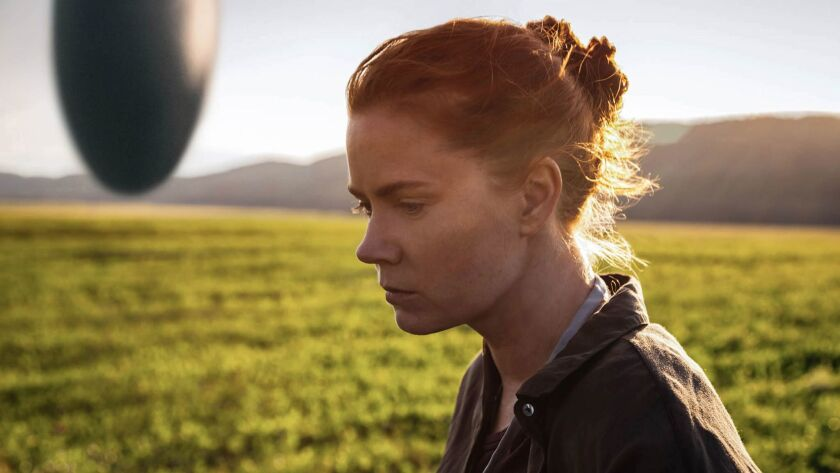 """Recordings of shifting rocks and ice helped make the sound of """"Arrival's"""" egg-shaped heptapod spacecraft, seen here with Amy Adams as Louise Banks."""
