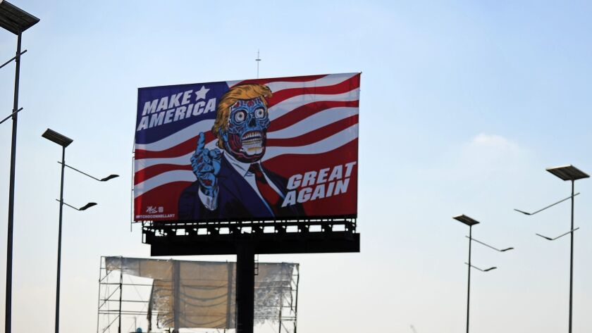 A billboard by U.S. artist Mitch O'Connell depicting President Trump is displayed in Naucalpan de Juarez, in the state of Mexico.