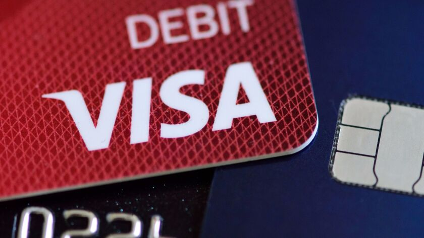 A Visa debit card is pictured with a chip-enabled card.