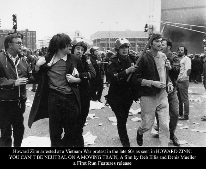Howard Zinn, whose views were shaped by his experiences as a bombardier in World War II, is arrested during a Vietnam War protest.