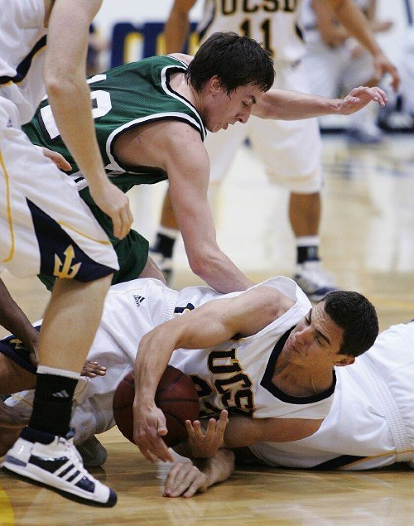 UCSD's Casey Ryan scrambles for a loose ball in the Tritons' first-round tournament win. Humboldt State's Ernie Spada is empty-handed.