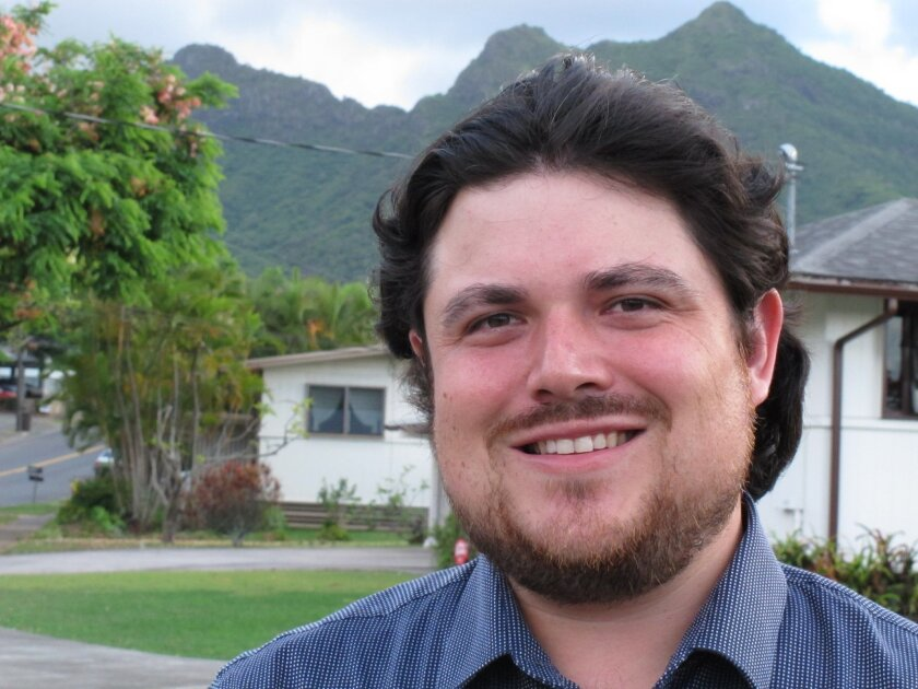 In this July 30, 2014, photo, Oskar Garcia, a news editor for The Associated Press in Hawaii, poses for a portrait in Kailua, Hawaii. Garcia, who oversees news coverage of Hawaii and the Pacific Rim, has been appointed assistant sports editor for the east region for the news agency. Garcia, current