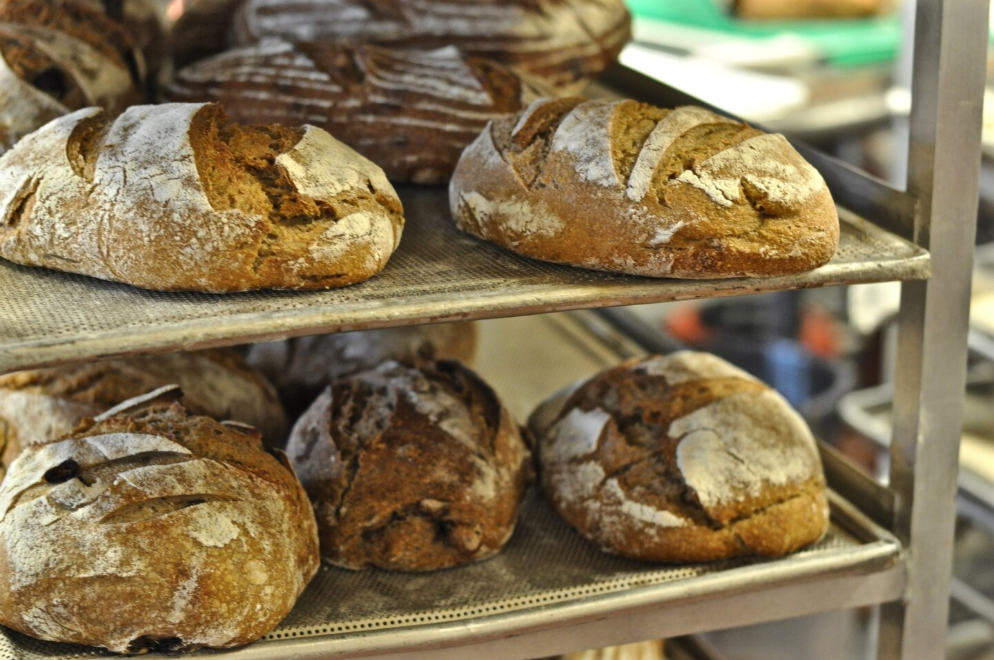 Loaves of whole grain bread rest in the kitchen near the deck oven at Seed Bakery in Pasadena.