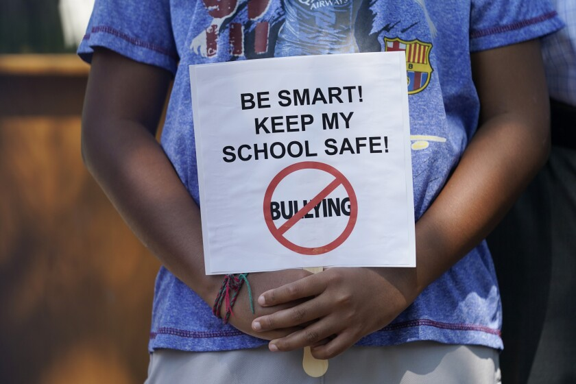 Protester's placard on keeping schools safe from COVID-19