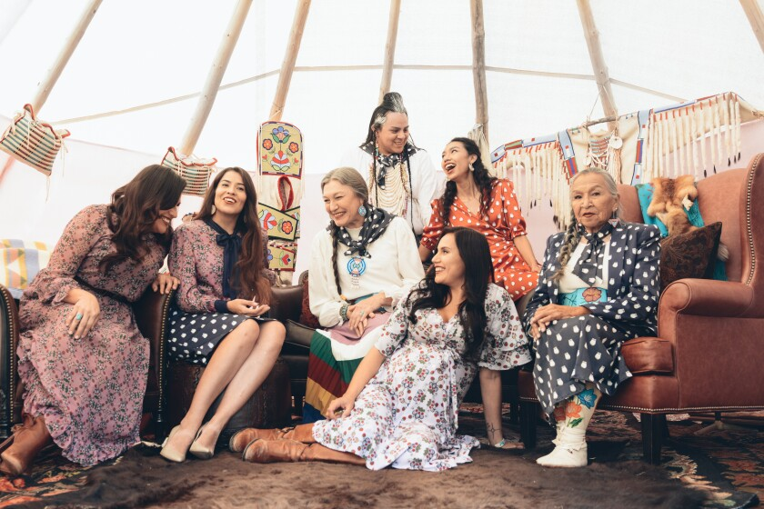 Native American models across generations gather inside a tepee to model B.Yellowtail's Heritage Collection.