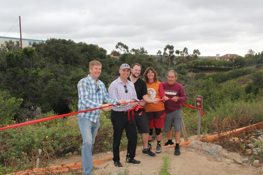 San Diego Mountain Bike Association members Matt Bartlet, Susie Murphy, Rich Julien and Ben Stone with Allen Kashani of Pardee Homes. Photo by Karen Billing