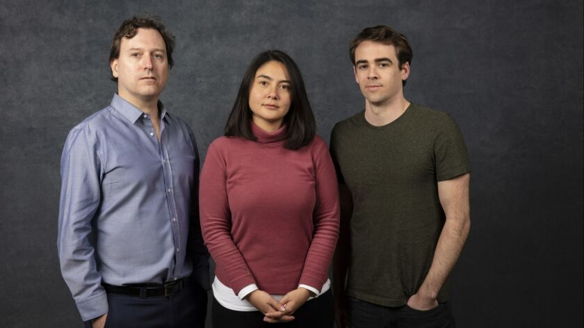 Wall Street Journal reporter John Carreyrou, left, with Theranos whistle-blowers Erika Cheung and Tyler Shultz at the Sundance Film Festival in January.