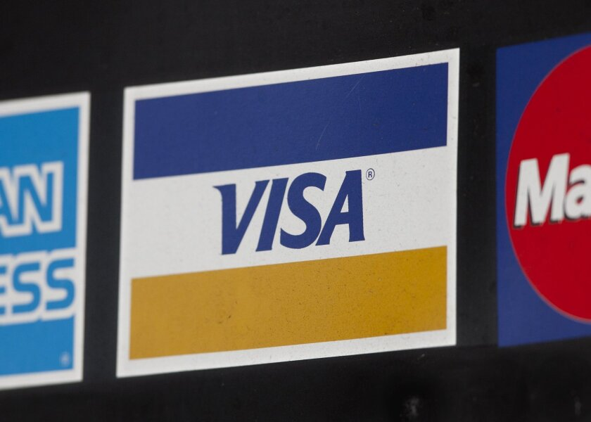 FILE - In this March 19, 2012 file photo, a sign for Visa is shown in New York. Visa plans to buy Visa Europe in a cash-and-stock deal that could be worth more than $23 billion. (AP Photo/Mark Lennihan, File)