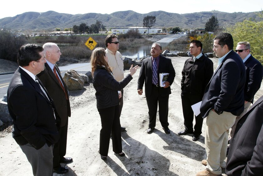 U.S. Rep. Duncan Hunter's Chief of Staff Vicki Middleton, third from left, asks questions of city officials from Murrieta and Temecula who were leading a tour of Murrieta Creek to point out the importance of a planned flood control project.