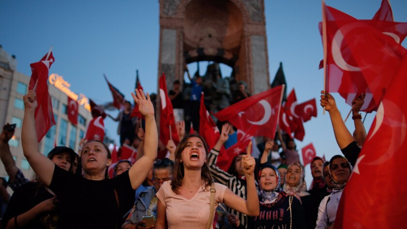 People chant slogans as they gather at a pro-government rally in central Istanbul's Taksim square, Turkey in July.
